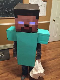Minecraft Herobrine costume. Eyes light up using glow sticks taped inside behind white felt.