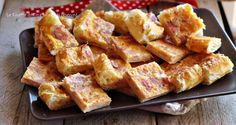 Torta prosciutto cotto e formaggio,una ricetta gustosa facile e veloce,da servire per cena tagliata a fette o a quadrotti e servita come antipasto