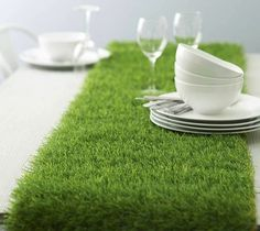 Add a contemporary yet summery twist to your dining table with an artificial grass table runner.