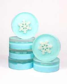 Learn how to create a collection of simple, yet elegant winter snowflake soap favors! These snowflake soaps make wonderful gifts for teachers or co-workers and are also stunning as DIY snowflake soap wedding favors. Plus you won't believe how simple they are to make!