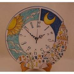 C2 - Medium sized ceramic plate clock with lemons and an intricate pattern, hand crafted and hand painted...a lovely piece of art! Battery operated, this clock may be hung on a wall or used in a plate stand (sold separately)