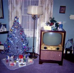 I grew up with these trees for a couple yrs. ...vintage living room