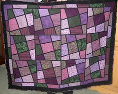 Google Image Result for http://quiltinggallery.com/wp-content/uploads/2008/01/mishka-magic-tiles-purple.jpg