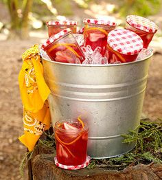 We filled old jam jars with juice and kept them cold in an ice-filled pail until ready to serve.