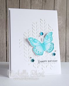 Fun use of chevron stencil and embossing paste to make background of this card.