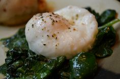 Microwave poached egg.  Did this - minus that leafy thing.  It's good.