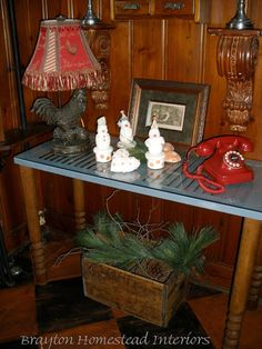 Entryway What I like: Old shutter table, Rooster red accent lamp, wood trim made into shelves, little box underneath for storage or seasonal decorating