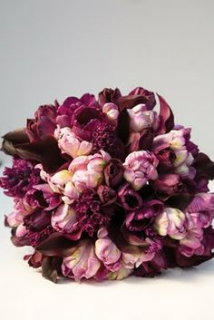 bridal bouquet of eggplant mini cala lilies, lavender parrot tulips, dark purple tulips and plum hyacinth