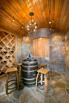 Tasting table. Place a wine barrel in your cellar as a dedicated space for tasting. This playful and dedicated touch is great for small cellars with limited room.