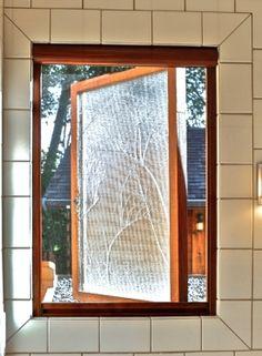 retractable serene window screens on a casement window preserve