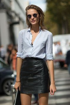 Light blue shirt & black leather skirt