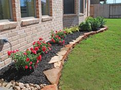 Plants look so vibrant next to the black mulch outside pinterest pretty flowerbeds to line the house mightylinksfo