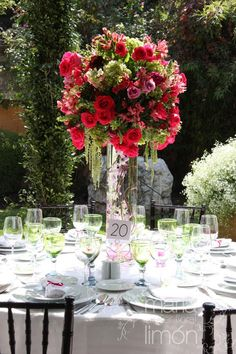 Tall wedding arrangement   #fucsia #green #wedding #centerpiece #flowers