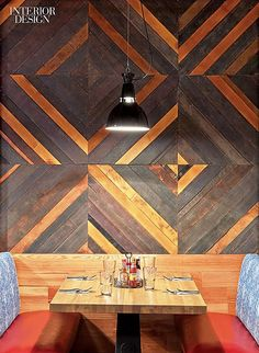 Rustic ttimber wall panelling with a contemporary design. I like the pattern and line in the design of the wall.