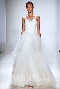 A flowy #weddingdress with illusion straps by @amsale   Brides.com