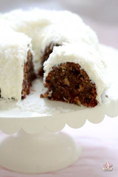 Rich rum fruitcake bundt cake with coconut cream cheese icing via Sweetopia.