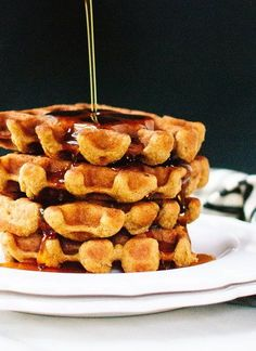 Spiced pumpkin waffles that are crispy on the outside & fluffy on the inside. This easy, gluten-free pumpkin waffle recipe's secret ingredient is oat flour!