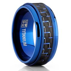Make a modern fashion statement with this durable titanium ring for men by Oliveti. A stunning rich black and blue carbon fiber is inlaid in the center the ring. The band is plated with rich blue plating and it is finished with high polish beveled edges.