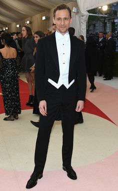 Tom Hiddleston from 2016 Emmy Nominees' Best Looks  Before his famous impromptu dance-off withTaylor Swift, the actor posedfor photos at the2016 MET Gala in aRalph Lauren Purple Label evening suit. The British actor is nominated for his first Emmy, for his role inThe Night Manager.