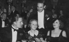 Marlene Dietriech with her husband and daughter in a restaurant, 1935