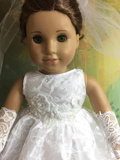 Gorgeous bridal lace lined gown with lace Beaded trim on sash. Flower clip Beaded lace veil to match. Comes with pretty lace gloves. Beautiful!! Made for 18 inch dolls.