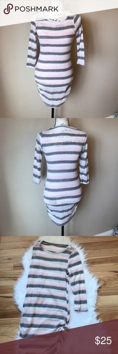 Pink & grey striped knit top Pink and great striped knit top with 3/4 sleeve. 95% polyester 5% spandex. Perfect with leggings and boots! Also available in blue! auditions Tops