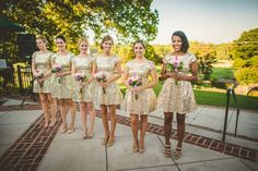 Gold sequence bridesmaids dresses.