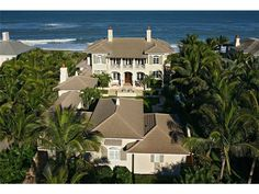 Turquoise waters give the idyllic backdrop for this impressive island-inspired direct oceanfront estate. Designed to give sizable groups of family & friends maximum privacy, the main residence & separate guest house surround a gorgeous pool courtyard. Elevator. Dune walkway to 125+/- ft beachfront. A private world within a resort paradise. Sizes approx and subj to errror.