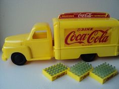 yellow plastic toy vintage coca cola truck