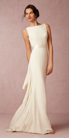 @badgleymischka Valentina dress from @BHLDN is for the bride that wants an understated and timeless look on her wedding dress. This column style gown with ruffles in the back is so sophisticated.