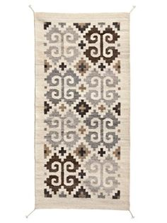 A 500-year-old design hand-loomed and hand-woven by Zapotec Indians in Mexico. No dyes are used. 100% wool.
