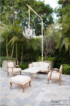 outdoor seating with armed chandelier. LOVE