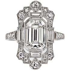 2.03 Carat GIA Cert Emerald Cut Diamond Platinum Engagement Ring | From a unique collection of vintage engagement rings at https://www.1stdibs.com/jewelry/rings/engagement-rings/