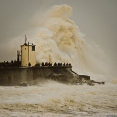 England battered by storms and flooding, February 2014. Waves break over Porthcawl harbour, South Wales