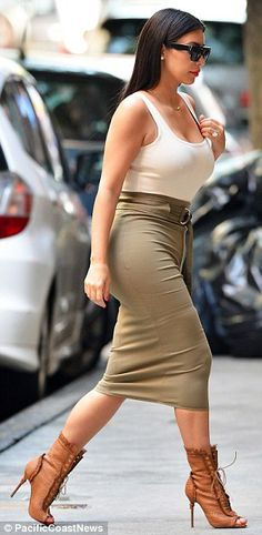 Effortlessly chic: The new Mrs West looking simply stunning as she paraded her famous killer curves in her figure-hugging ensemble