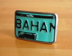 License Tag Buckle- Grand Bahama Island- HowlerBros.com Register your waist with no need to renew.  We hand selected vintage license plates and fashioned them into these badass License Tag Buckles. Each buckle is one of a kind limited edition. #accessories #belt #buckle #Bahamas #handmade