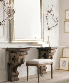 Rustic reclaimed console or vanity + huge mirror + glamorous sconces