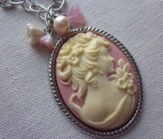 Lady of the Flowers. A large Victorian Cameo in Ivory and Pink on silver brass setting.