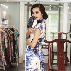 A Fair Lady    read full story: http://www.elegente.com/graceful-fashion-chinese-cheongsam-blue-flowers-printed.html