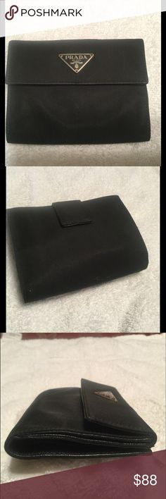 🌷Mother's Day sale🌷 Prada Nylon/Leather Wallet🌷 Gently Used Vintage Great Condition Prada Black Nylon/Leather Wallet with silver Hardware,coin department ,six credit card slots and A place for Bills. Prada Bags Wallets