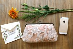 Read on to see how you can win this lace bridesmaid clutch for your MOH or bridesmaid (or, maybe just keep it for yourself. We won't tell.) Enjoy! #giveaway @emmalinebride