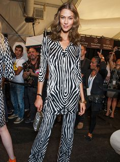 Karlie Kloss switching looks backstage at the DVF Spring 2014 runway show. See more: http://on.dvf.com/1KauiZh #FlashbackFriday