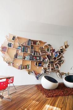 amazing bookcase... Within the map he fastened 600 tiny Christmas tree lights that represent the nation's major cities. a shelf based on Hawaii hangs in the kids' bathroom (each island is a hook), and Alaska is suspended in the upstairs bathroom over the tub.