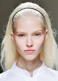 Loving the way this thin black headband looks on platinum blonde hair