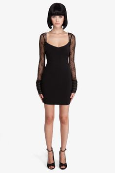 Fitted stretch jersey dress in black. Wide square neck. Sheer lace shoulders, long sleeves and v back.