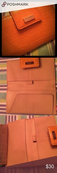 Kate Spade Orange Wallet Kate Spade Orange & Silver Wallet. Faux croc. Snap closure. Three card holder. Checkbook and pen holder. I could also fit my iPhone inside, and the snap closure would hold it in place. Small scratches on silver logo. It's so cute; it just doesn't go very well with my new purses. Check out the bundle recommendation photos!!! 30% off bundles of two or more!!! kate spade Bags Wallets