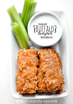 "Baked Buffalo Tempeh Tenders -      8 2"" slices of tempeh, lightly steamed     2 c. Rice Chex (or crunchy gluten free cereal)     1 c. store-bought buffalo sauce     ¼ tsp. smoked paprika     ⅛ tsp. cayenne pepper     Veganaise Blue Cheese Dressing"