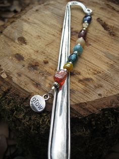 Mark your spot in your favorite book in style. No more folded pages or index cards. Simply place the metal shepard's hook in between your pages while the beautiful beads hang out against the binding.