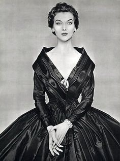 Rose Marie is wearing this 18th century-inspired evening gown of black taffeta and moire by Givenchy, L'Officiel 1954