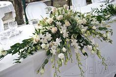 centrotavola matrimonio con fiori bianchi